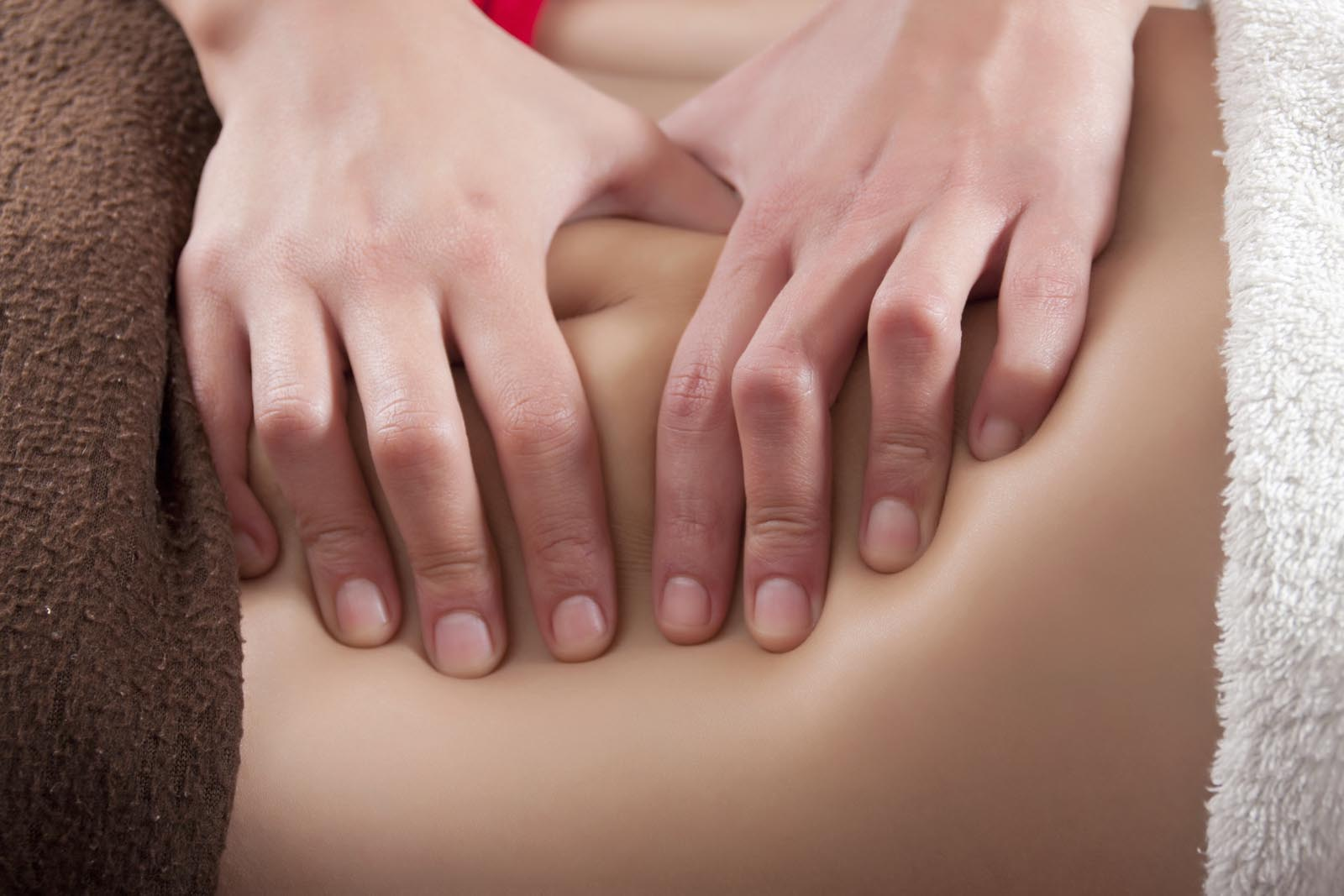 osteopathy procedure on the belly