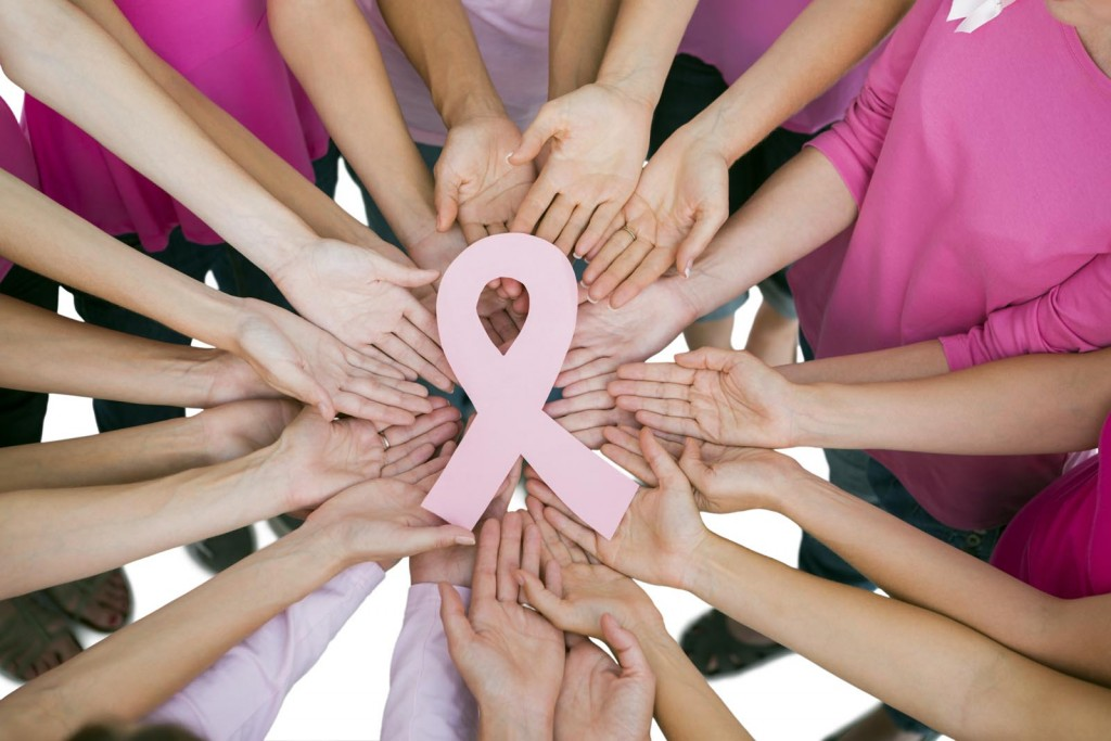 Hands joined in circle holding breast cancer struggle symbol  on white background