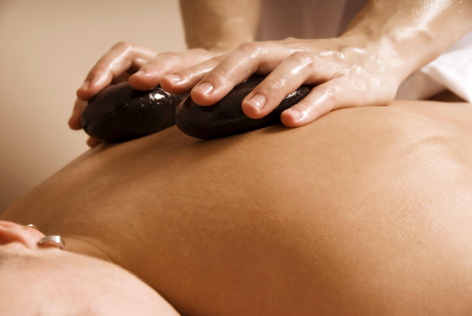 woman in a day spa getting a stone treatment